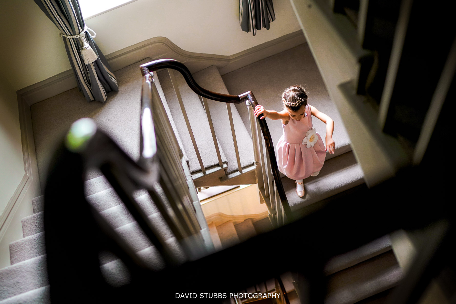 flower girl walking down the stairs