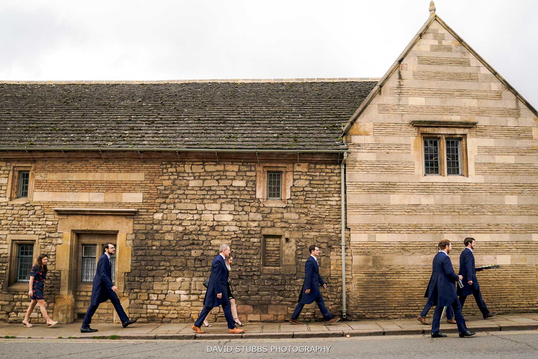 groom walking to the church through stamford