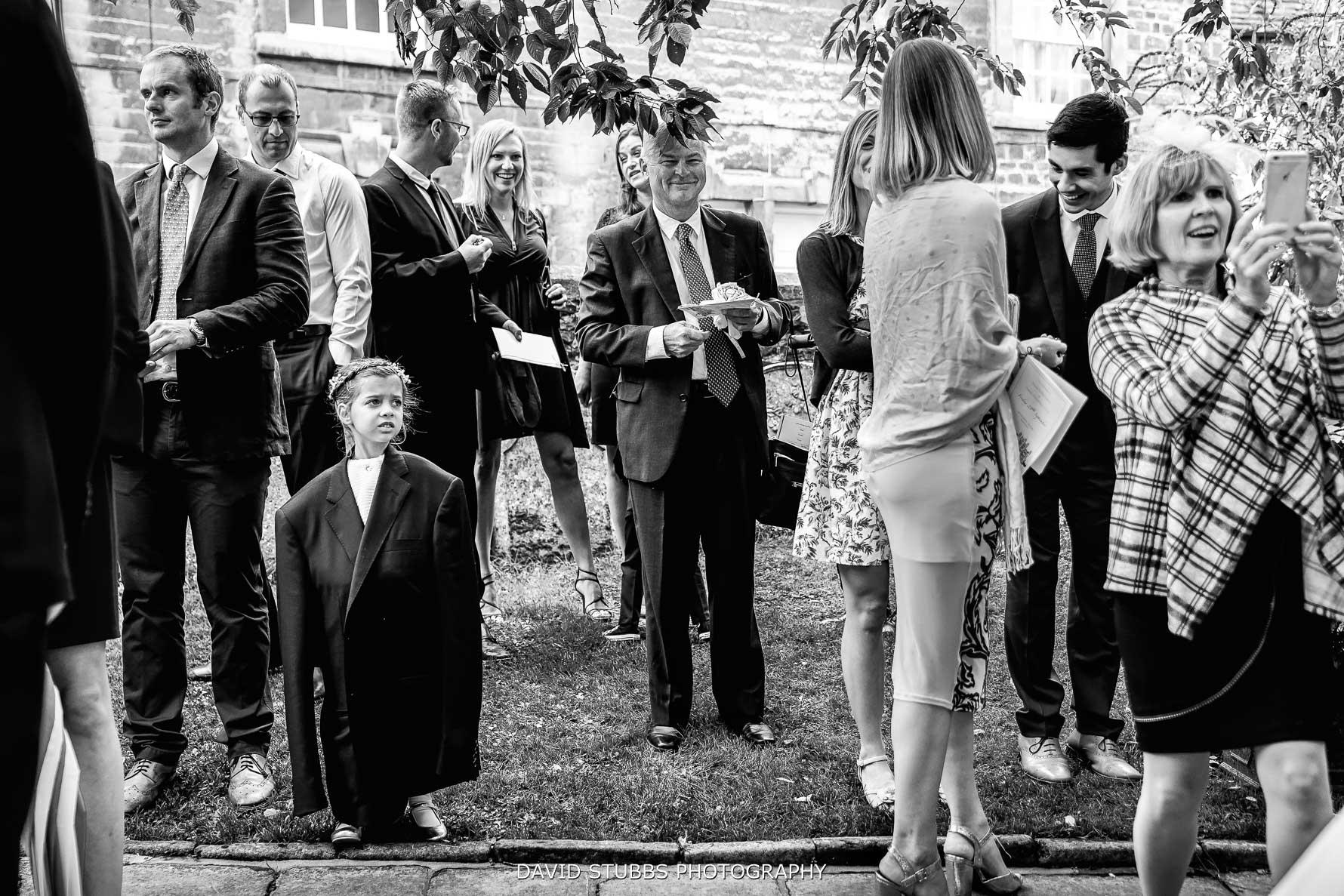 girls in dads jacket at wedding