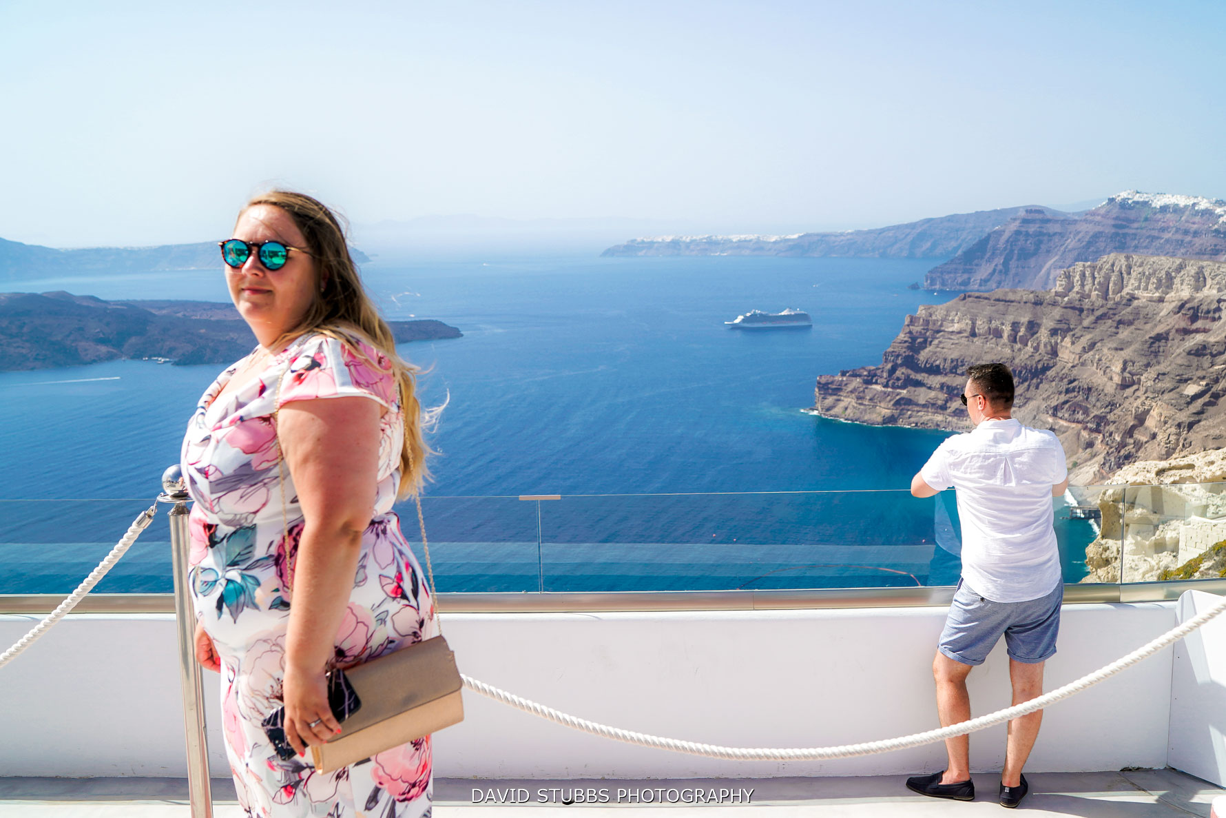 looking out over the view of Santorini bay at wedding