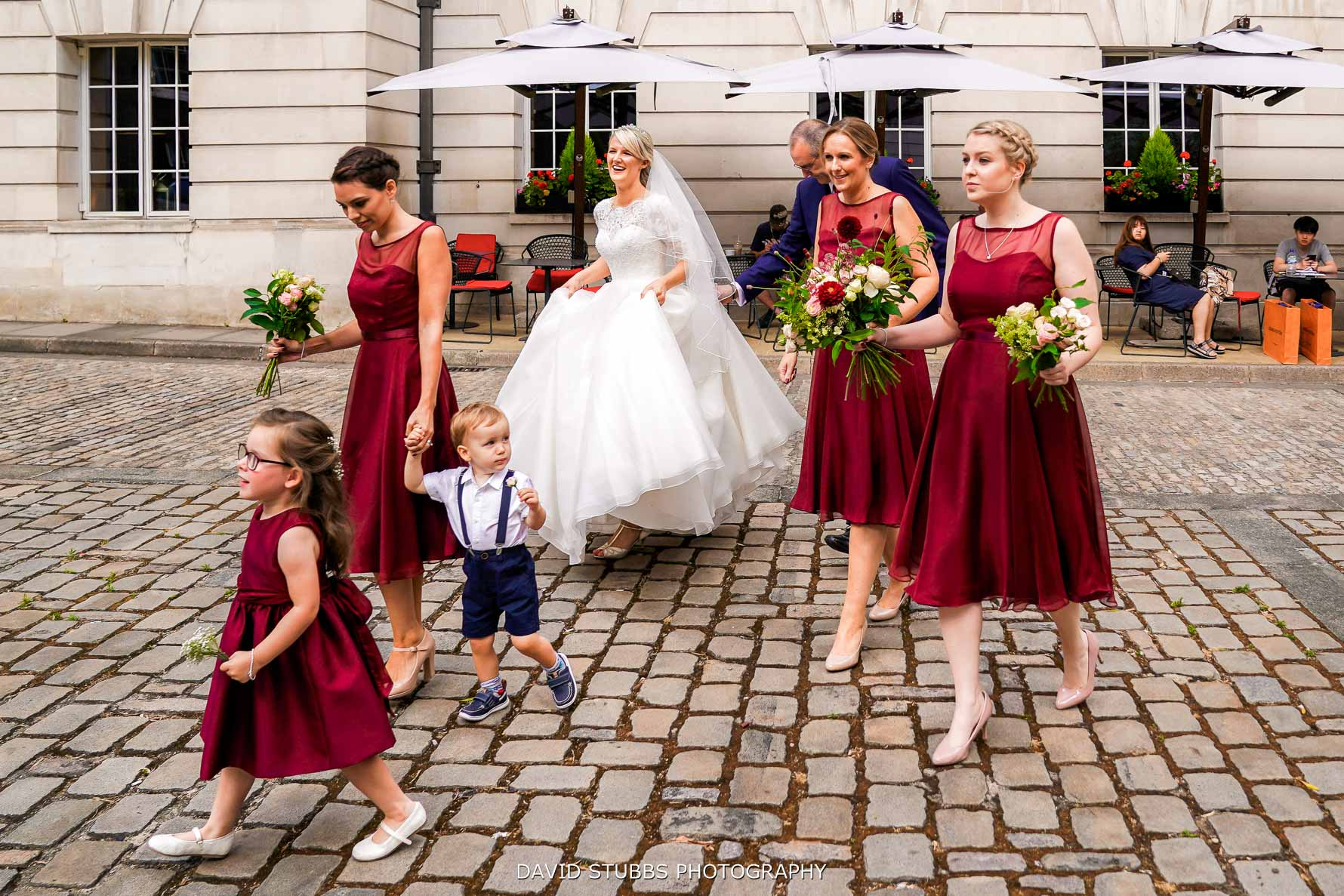 bridal party walk across the court