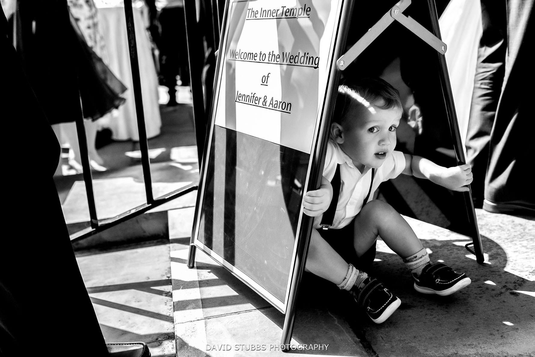 kid under sign at inner temple wedding