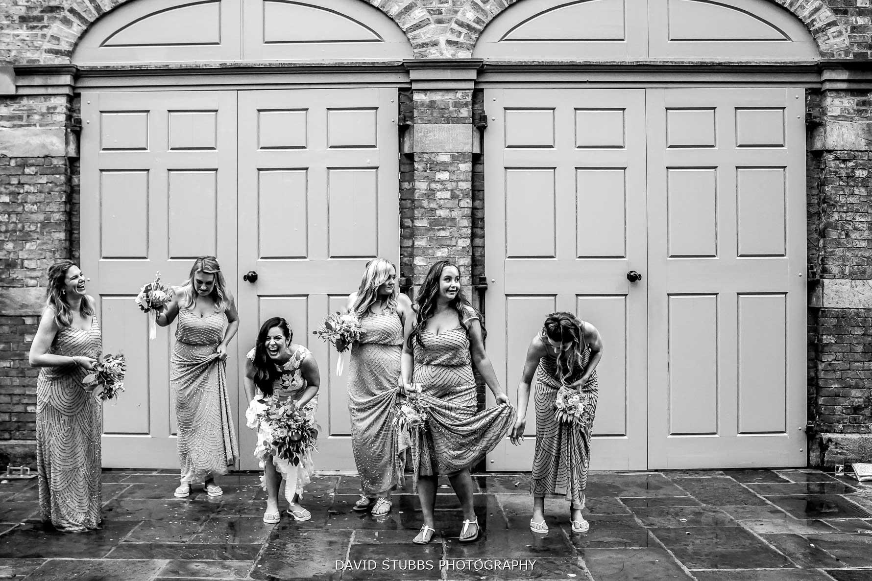 bridesmaids having fun outside dorfold hall barn