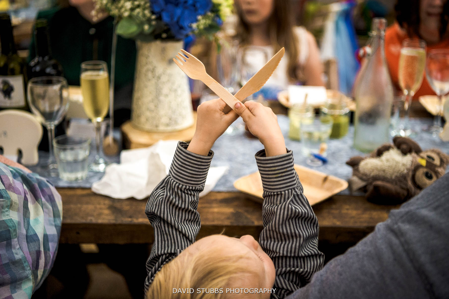 kid crossing cutlery