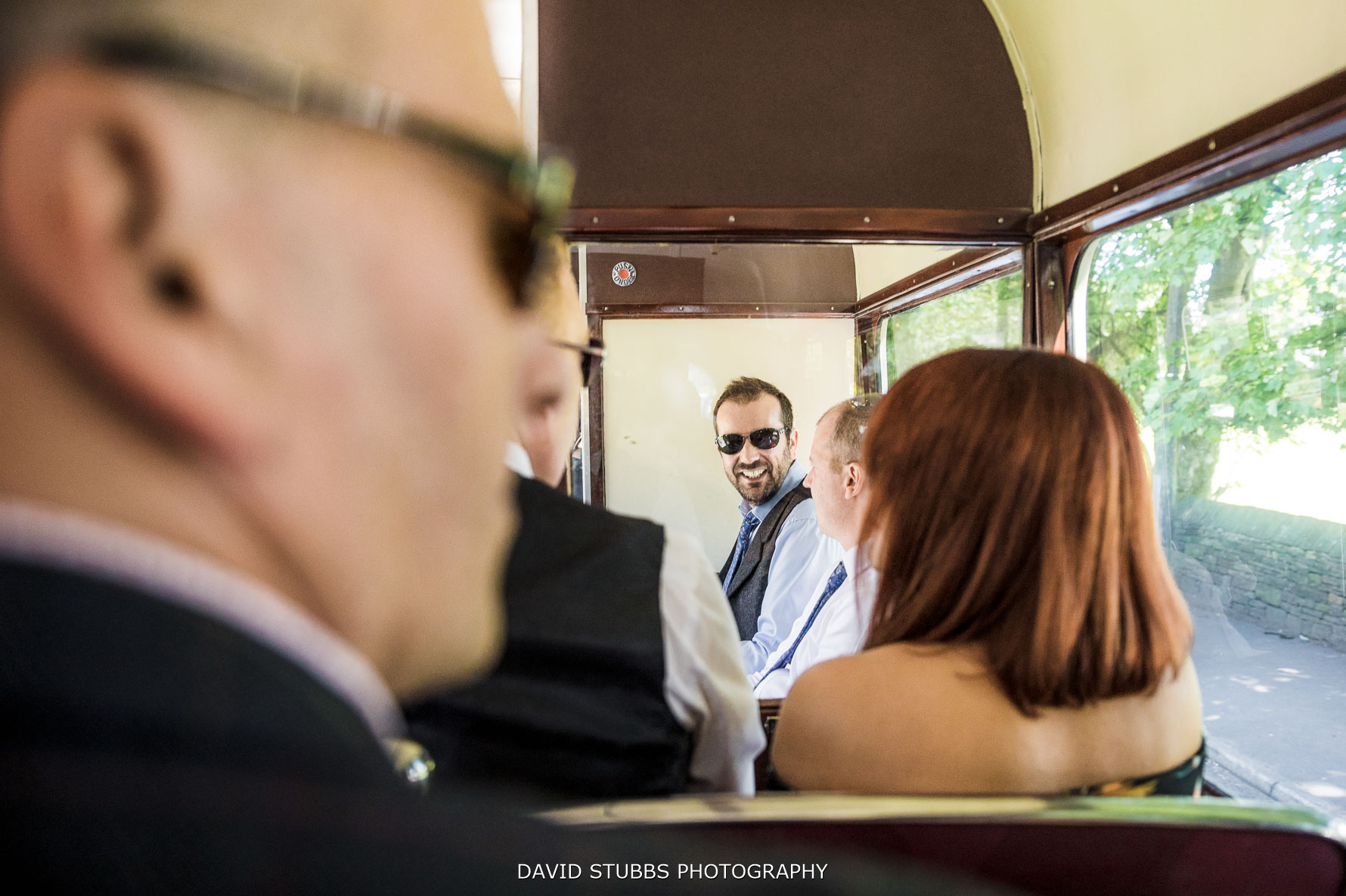groom travelling on the vintage bus to his wedding