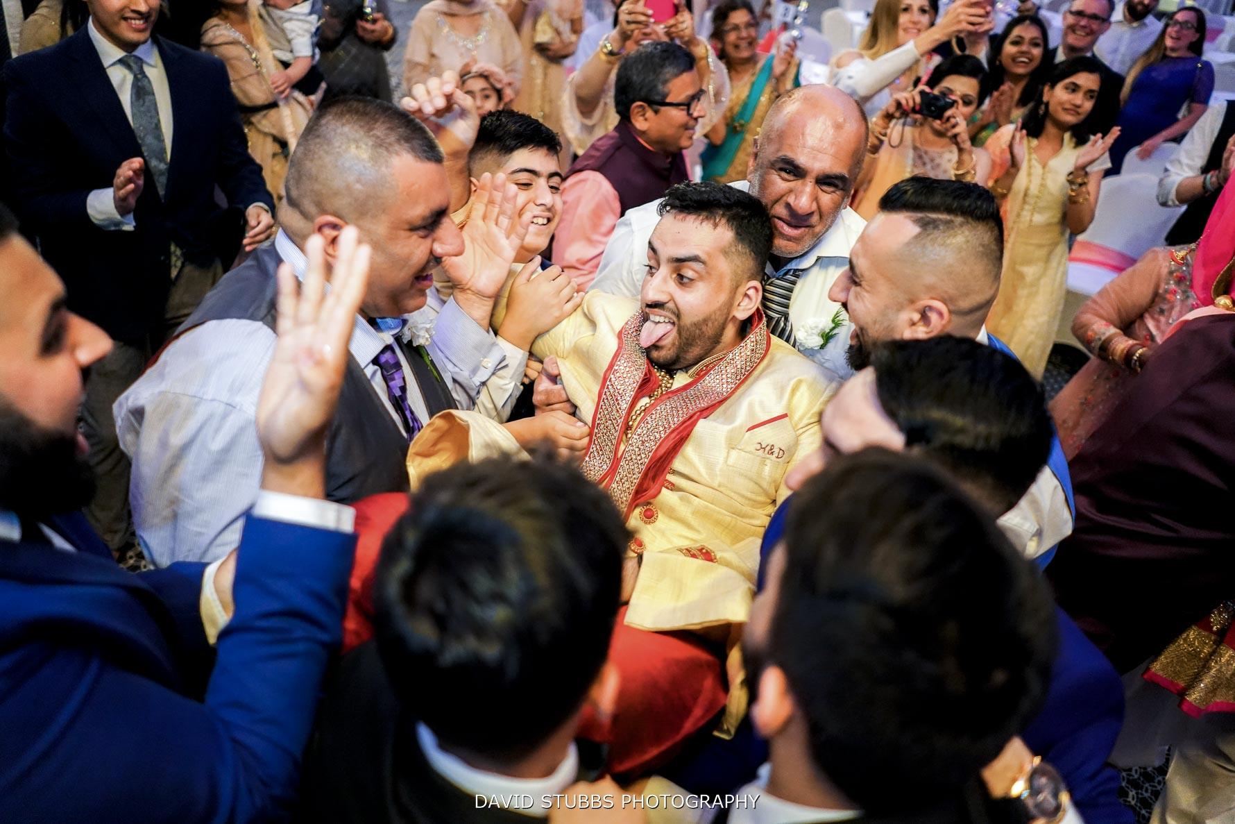 groom dancing at his wedding