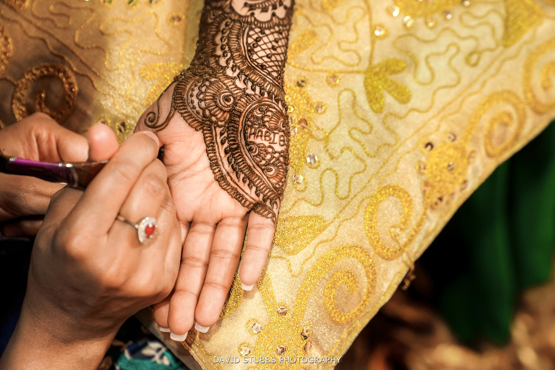 close up of the mendi on hr hands
